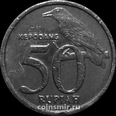 50 рупий 1999 Индонезия. Иволга. Состояние на фото.
