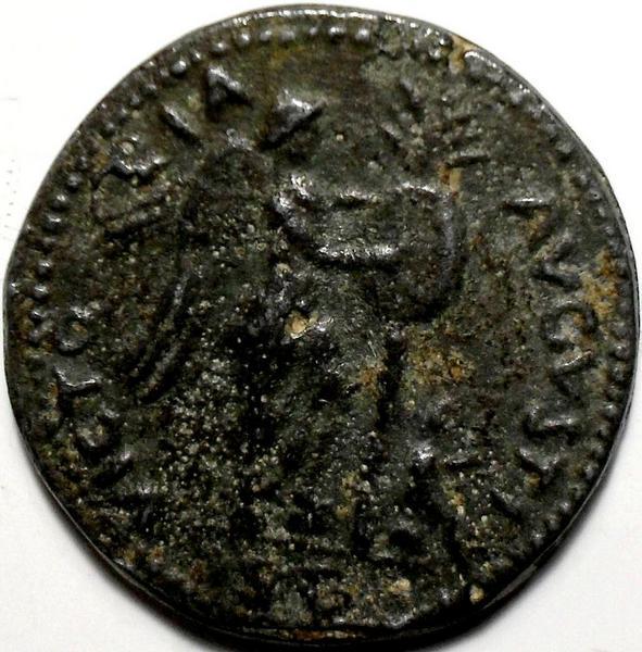 Жетон в виде старинной монеты.