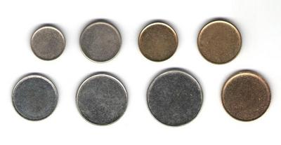 Набор заготовок для российских монет регулярного чекана образца 1997 года  1 коп., 5 коп., 10 коп., 50 коп., 1 рубль, 2 рубля, 5 рублей и 10 рублей.